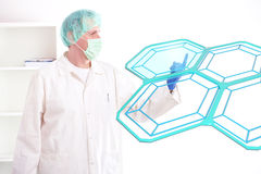 Researcher testing cells in the laboratory. Researcher or a medic examining cells. This could be futuristic doctor using genetic engineering techniques or Stock Image