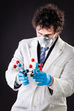 Researcher with a tnt molecule Stock Photography