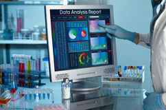 Researcher touching the screen of report research data. Analyzing data scientist in the laboratory with a screen project development / researcher touching the Royalty Free Stock Image