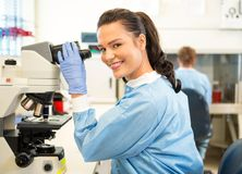 Researcher Using Microscope In Laboratory Royalty Free Stock Images
