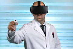 Researcher wearing virtual reality glasses conducting a work rem Stock Photo