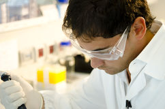Researcher at work. Wearing goggles Stock Photography