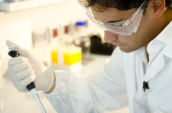 Researcher at work. Wearing goggles Royalty Free Stock Photos