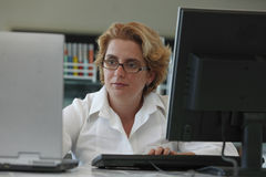 Researcher working on computers Stock Image