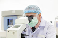 Researcher working with microscope Royalty Free Stock Images