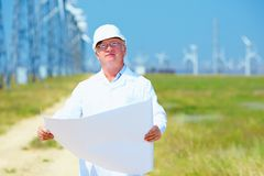 Researcher working on project on wind power station Stock Photos