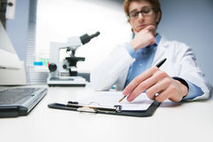 Researcher writing notes Royalty Free Stock Photos