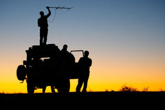 Researchers. A team of researchers using radio telemetry to locate their study animals Stock Image