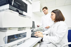 Researchers analyzing liquid chromatography data Stock Photos