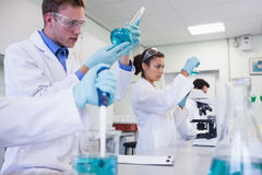 Researchers carrying out experiments in the lab Royalty Free Stock Photography