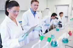 Researchers carrying out experiments in the lab Stock Images