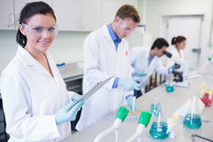 Researchers carrying out experiments in the lab Stock Image