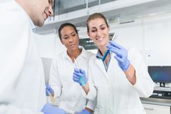Researchers doing experiment in science lab stock photography