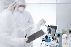 Researchers evaluating chemical analysis Royalty Free Stock Image