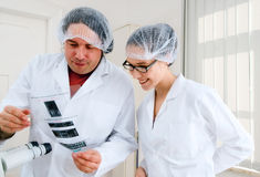 Researchers examine results of DNA analysis. By PCR stock images