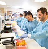 Researchers Experimenting In Laboratory stock photos