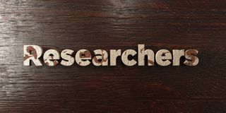 Researchers - grungy wooden headline on Maple  - 3D rendered royalty free stock image Stock Image
