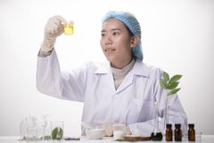 researchers Health care working in life science laboratory. Young female research scientist preparing and analyzing microscope stock image