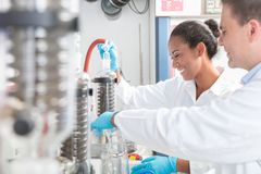 Researchers preparing test in scientific laboratory royalty free stock image