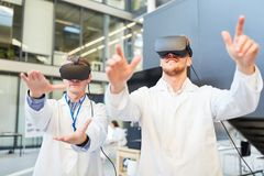 Researchers train with VR glasses for medicine. Researchers train sensory perception with VR glasses for medical diagnostics stock photos