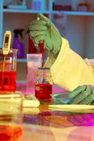 Researchers work in modern scientific lab. Preparation of hazardous solution stock photos