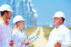 Researchers at work  on wind power station Stock Image
