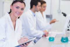 Researchers working on experiments in the laboratory Royalty Free Stock Image