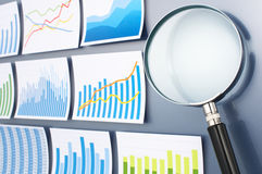 Researching and analyzing data with magnifying glass. Trend surv Royalty Free Stock Image