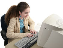 Researching Homework Online. A school girl researching her homework online royalty free stock photography