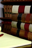 Law Books. And note pad being used for research Royalty Free Stock Images
