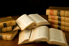 Researching the law. Scattered law books being used for research Royalty Free Stock Photography
