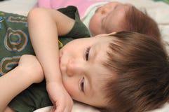 Resentful boy jealous little baby. Resentful boy jealous little sister Stock Photography