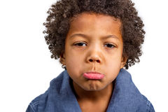 Resentful boy. Rolled out lip and look displeased Royalty Free Stock Images