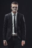 Resentful businessman with a makeup the skeleton Stock Images
