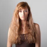Resentful casual girl on gray. Resentful casual caucasian girl with long brown hair on gray background Stock Image