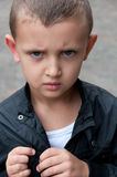 Resentful a little boy. Of five years outside Royalty Free Stock Photos