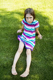 Resentful. Outdoors portrait of small girl with offended look Royalty Free Stock Image
