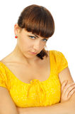 Resentful young girl in yellow dress Royalty Free Stock Image