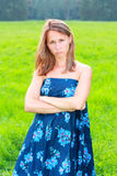 A resentful young woman in blue dress Royalty Free Stock Photos