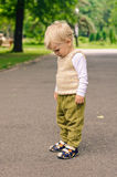 Resentment. Little boy on stroll in the park Royalty Free Stock Photo