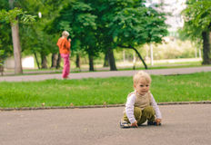 Resentment. Little boy on stroll in the park Stock Photos