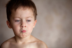 Resentment. Little boy is full of emotions Stock Images
