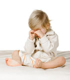 Resentment. Little boy in the bed on white background, he rubs eyes Royalty Free Stock Image
