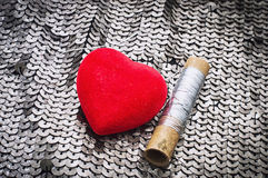 Resentment. Symbolic heart and thread,as symbol of quarrel between pair Royalty Free Stock Image