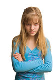 Resentment of young girl in blue. Resentment of young blonde girl in blue dress Royalty Free Stock Photos