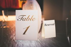 Reservation Card on a Table. Used for saving seats at a table for a wedding Stock Photos