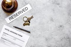Reservation form on hotel reception desk background top view mock up. Room reservation form on hotel reception desk background top view mock up Royalty Free Stock Photography