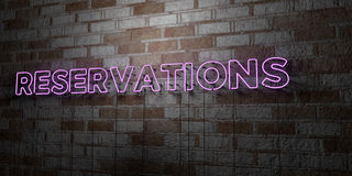 RESERVATIONS - Glowing Neon Sign on stonework wall - 3D rendered royalty free stock illustration. Can be used for online banner ads and direct mailers Stock Photos