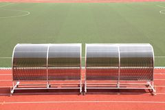 Reserve benches football field Stock Images