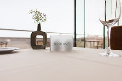 Reserve sign on restaurant table Stock Photo